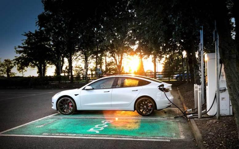 Tesla Model 3 Charging at Sunset